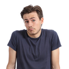 Front portrait of a young man doubting shrugging shoulders