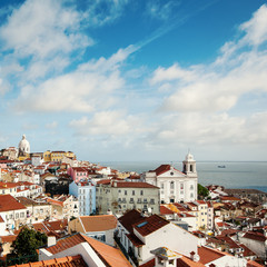 Beautiful view of old city from Alfama with cloudy sky. Lisbon,