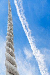 rope rises to blue sky with white clouds