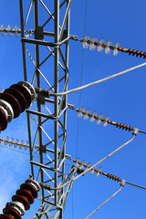 insulators and electric cables in a large power plant