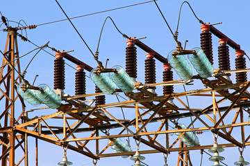 great insulators in a power plant with tall pylons of high volta