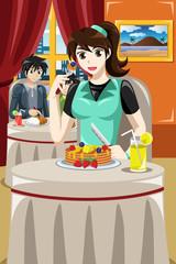 Woman eating fruit pancakes