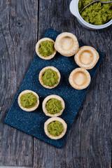 Mini tarts with broccoli puree
