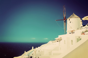 Oia town on Santorini island, Greece.  Famous windmills