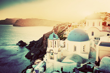 Oia town on Santorini, Greece at sunset. Aegean sea, vintage