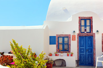 Traditional Greek house with blue door, Santorini, Greece