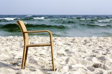 A chair on an empty beach