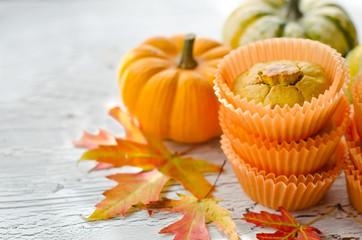 Orange pumpkin cupcakes with fresh pumpkins copy space