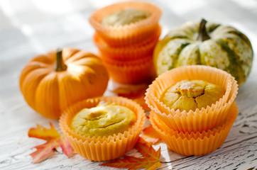 Healthy Pumpkin muffins with fresh pumpkins for autumn dessert
