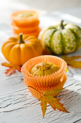 Orange pumpkin muffins with autumn leaves