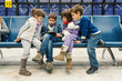 Kids waiting for flight inside Lisbon airport. Portela Airport i