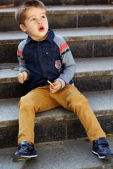 Little toddler boy in autumn park