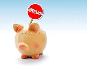 """Broken piggy bank with cracks and """"Deprivation"""" tag"""