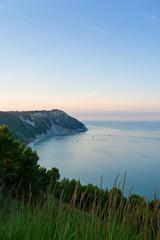 Scenic view of Portonovo beach at sunset. Ancona, Marche, Italy.