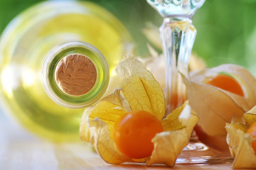 bottle of  white wine and physalis fruits