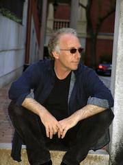 man sitting outside wearing sunglasses