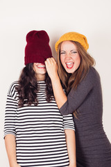 Funny girl friends with wool caps