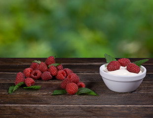 Raspberry, Mint and Cream on Wooden Table in a Village