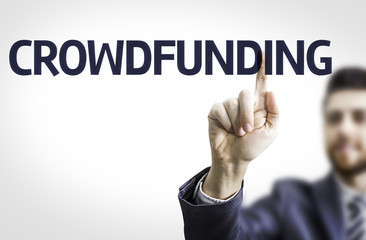Business man pointing the text: Crowdfunding
