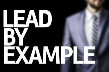Lead By Example written on a board