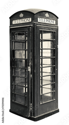 Classic British phone booth in London UK, isolated on white