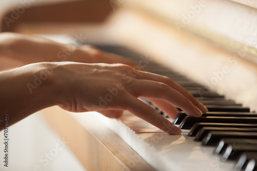 woman hands playing piano - 70395422