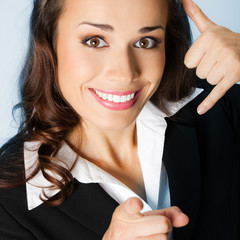 Businesswoman with call me gesture, over blue