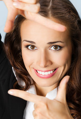 Businesswoman framing her face with hands