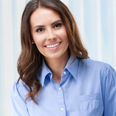 Young smiling businesswoman at office
