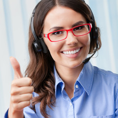 Support phone operator in headset with thumbs up