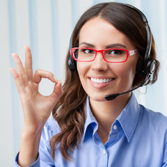 Support phone operator in headset, showing okay