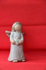 Kleiner Engel mit Weihnachtsstern