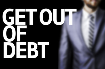 Get Out of Debt written on a board