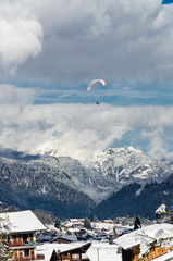 Paragliders flying over the mountain