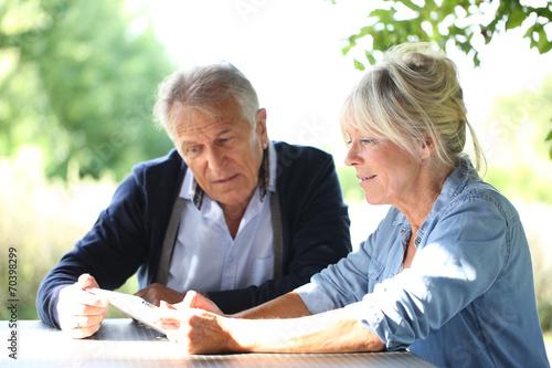 canvas print picture Senior couple using digital tablet