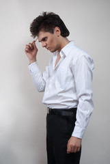 Handsome man in white shirt. Studio white background.