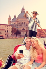 Couple in Venice on Gondola ride on canal grande