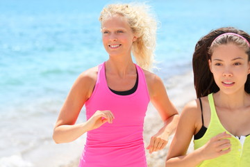 Running women jogging on beach