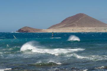 Surfers at the beach El Medano, Tenerife-Spain