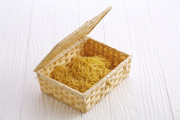 chinese dry noodle in wooden box on white background
