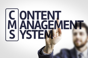 Business man pointing the text: Content Management System