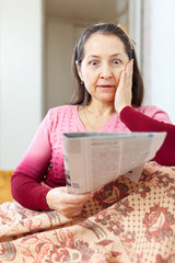 wonderingly  woman having grief after readed   newspaper
