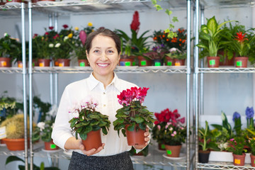 woman with Cyclamen surrounded by different flowers