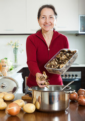 Woman with dried mushrooms