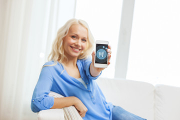 smiling woman with smartphone at home