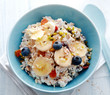 Leinwanddruck Bild - Bowl of breakfast cereal topped with fruit