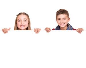 Kids behind a white board