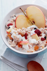 Healthy muesli with apple, dried fruit and nuts