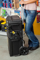 Woman Holding Tool Case In Store