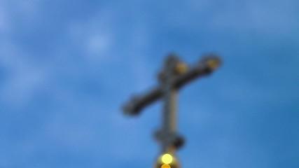 Golden cross on a blue sky